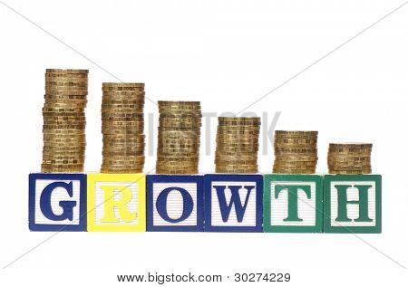 Monedas en la forma del diagrama y de la palabra crecimiento