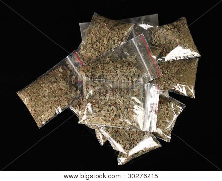 marihuana in packages on black background