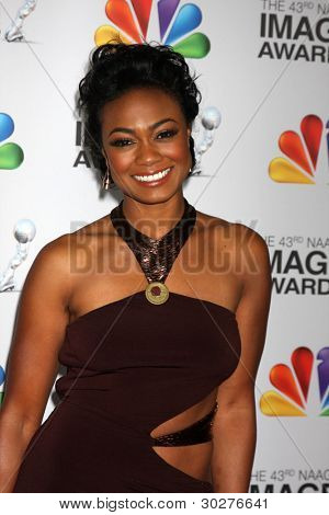 LOS ANGELES - FEB 17:  Tatyana Ali arrives at the 43rd NAACP Image Awards at the Shrine Auditorium on February 17, 2012 in Los Angeles, CA