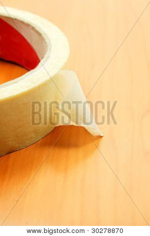 insulating tape on wood texture background