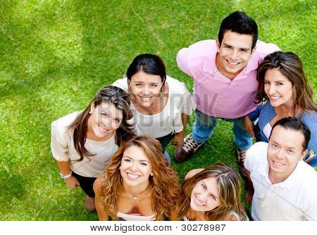 Group of young people smiling at the park