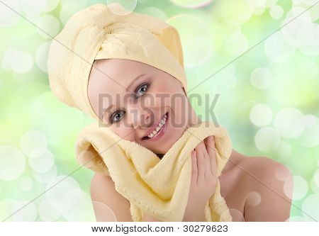 Beautiful Healthy Girl With Yellow Skin Wipes With A Soft Towel