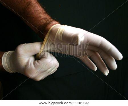 Man Putting On Latex Gloves