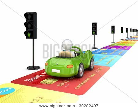Green car driving on a road made of credit cards.