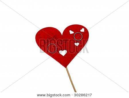 Wedding Rings Located On The Red Heart