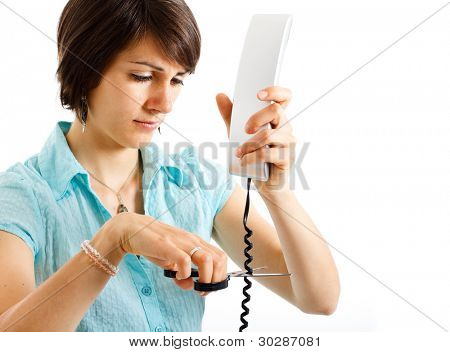Portrait of a stressed woman cutting a telephone cable