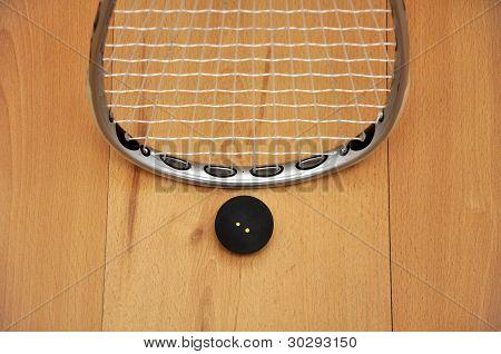Pelota y raqueta de squash