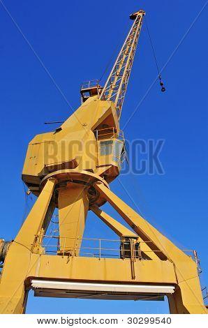 old gantry crane over the blue sky