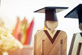 Back To School Concept, People Sign Wood With Graduation Celebrating Cap On Open Textbook Show Alter poster