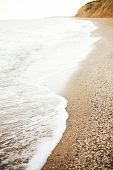 Beautiful Sea Waves Foam Closeup And Sandy Beach With Seashells On Tropical Island. Waves In Ocean B poster