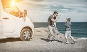 Happiness father and son, stay near them white travel car and look on the beautifull ocean coastline poster