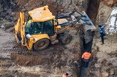 Excavator Works Near Trench On Construction Site poster