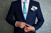 Businessman In Blue Suit Tying The Necktie. Smart Casual Outfit. Man Getting Ready For Work.the Morn poster