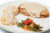 foto of biscuits gravy  - Homestyle Vegetarian Chicken Fried Steak Cream Gravy Biscuits and Stewed Tomatoes - JPG