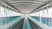 Modern Walkway Of Escalator Move Forward And Escalator Move Backward In International Airport. Escal poster