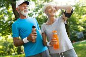 Senior Couple Staying Hydrated After Running Jogging poster