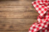 cloth napkin on at rustic wooden plank board table background, top view poster