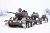 stock photo of panzer  - Row of Legendary Russian Tanks T34 in winter - JPG