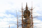 stock photo of heptagon  - big buddha statue which is under construction - JPG