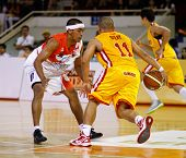 KUALA LUMPUR - FEBRUARY 19: Singapore Slingers' Donald Dulay (11) takes on Dragons Guganeswaran (0)