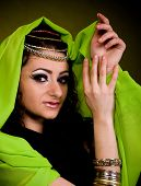 pic of yashmak  - Beautiful young woman in color arabian clothes - JPG
