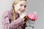 Happy Woman Holding Shopping Cart With Brain Inside. Clever, Responsible Buying Concept. poster
