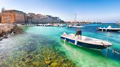 Several Fishing Boats At The Otranto Harbour - Coastal Town In Puglia With Turquoise Sea. Italian Va poster