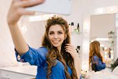 Attractive Young Joyful Woman In Blue Shirt With Long Brunette Hair Expressing Positive Emotions, Ma poster