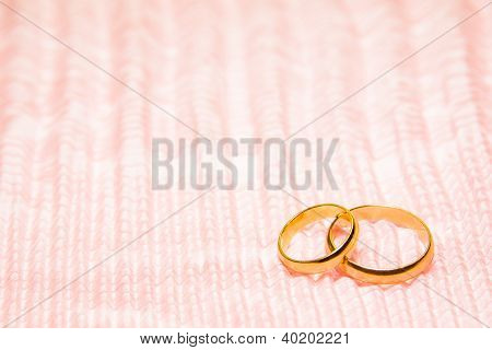 Two Gold Rings On Rosy Chiffon