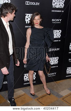 LOS ANGELES - DEC 10:  Milla Jovovich arrives to the 'Zero Dark Thirty' premiere at Dolby Theater on December 10, 2012 in Los Angeles, CA