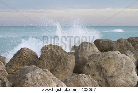 Waves Smash Against The Rocks On The Ocean Coastline