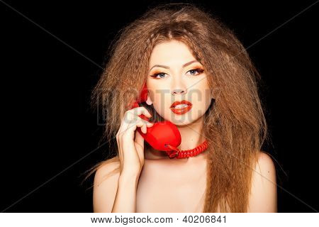 Hot Sensual Call Girl Talking On Red Telephone Isolated On Black