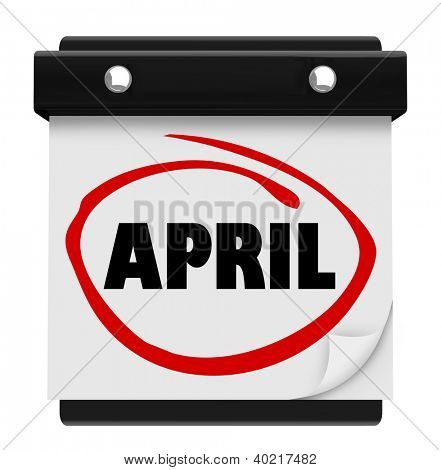 The word April on a wall calendar to remind you of important events during the Spring month and and Easter time