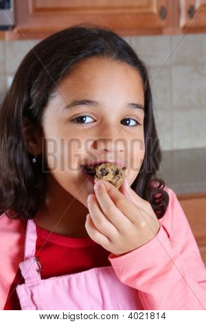 Girl Eating Dough