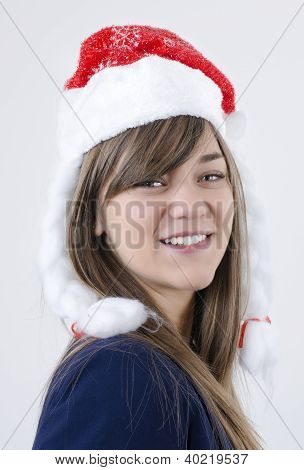 beautiful girl with pretty teeth,brown hair and New Year s cap on her head smiling