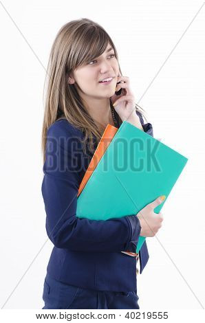 beautiful young business woman holding orange and green folder in her hand and talking on the phone