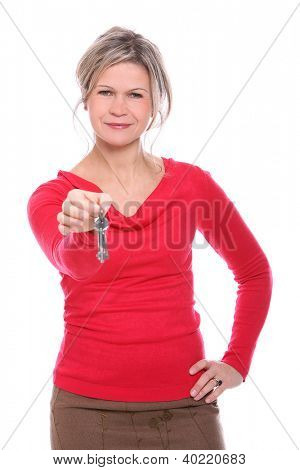 Beautiful mid aged blonde holding a keys over a white background