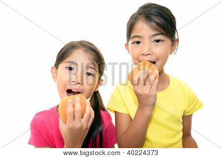 Girls eating bread