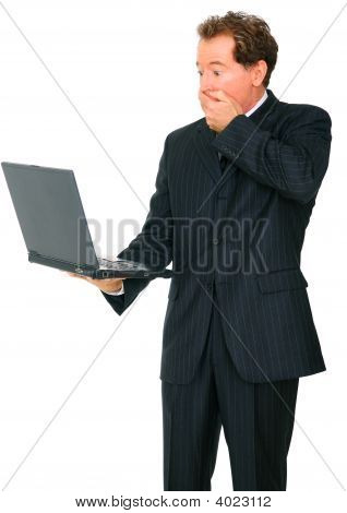 Isolated Senior Business Man Shocked Looking At Laptop