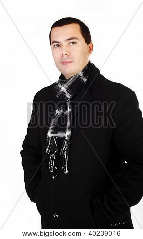 Young Handsome Man In Black Coat And Scarf Isolated