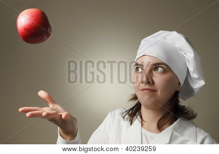 Chef Woman Throwing An Apple