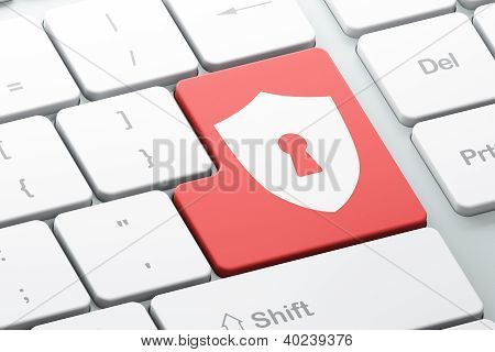 Enter button with shield with keyhole on computer keyboard