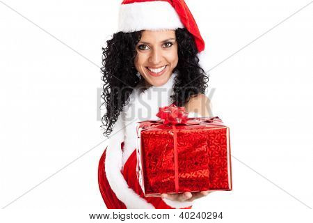 Portrait of a beautiful Christmas girl giving you a gift. Isolated on white