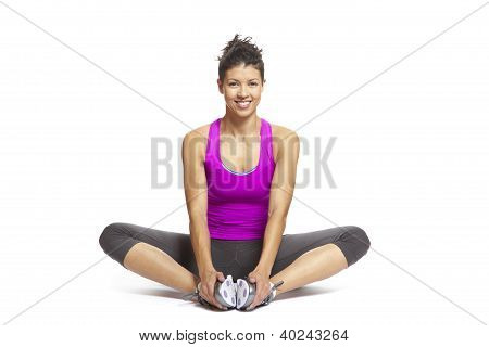 Young Woman In Yoga Pose Smiling