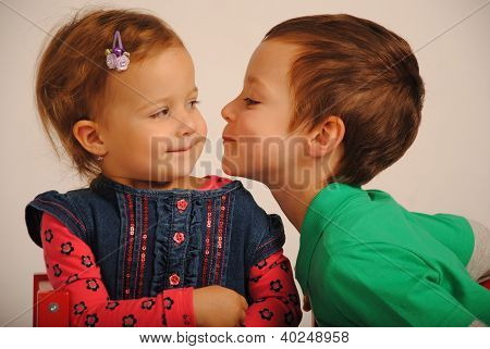Sibblings kissing.
