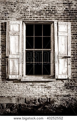 Old Window And Wood Shutters On Ancient Brick Wall