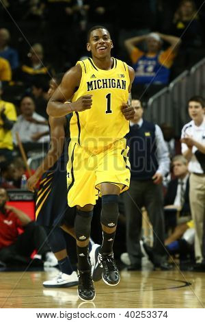 BROOKLYN-DEC 15: Michigan Wolverines forward Glenn Robinson III (1) reacts on the court against the West Virginia Mountaineers at Barclays Center on December 15, 2012 in Brooklyn.