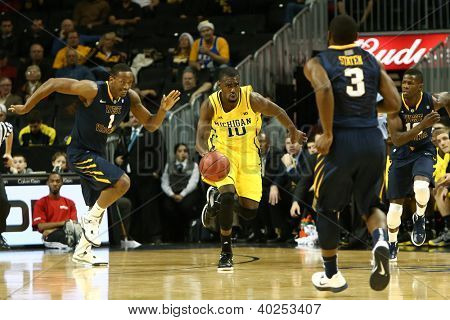BROOKLYN-DEC 15: Michigan Wolverines guard Tim Hardaway Jr. (10) dribbles the ball against the West Virginia Mountaineers during the first half at Barclays Center on December 15, 2012 in Brooklyn.