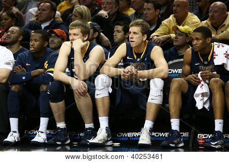 BROOKLYN-DEC 15: West Virginia Mountaineers players react on the bench against the Michigan Wolverines during the second half at Barclays Center on December 15, 2012 in Brooklyn.