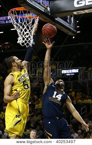 BROOKLYN-DEC 15: West Virginia Mountaineers guard Gary Browne (14) goes up for a shot as Michigan Wolverines forward Jordan Morgan (52) defends at Barclays Center on December 15, 2012 in Brooklyn.
